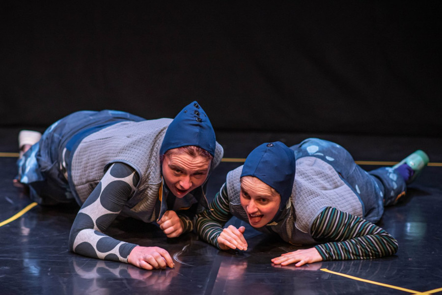 Bigkidlittlekid - two performer in blue engaged in a crawling race