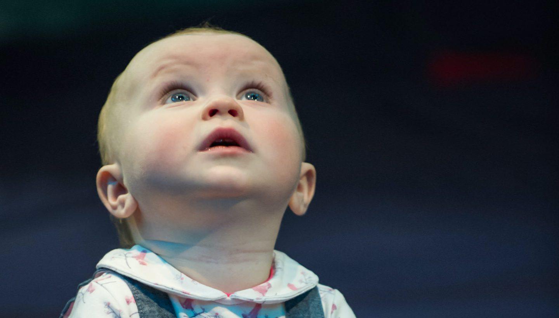 Baby Girl looks up in wonder
