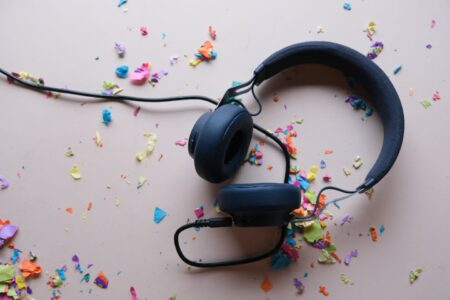 Adventures In My Ears - a set of headphones on a floor covered in confetti