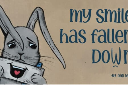 a drawing of a sad grey bunny who is holding a smile in front of his sad mouth. text reads 'my smile has fallen down by Dan Leith'